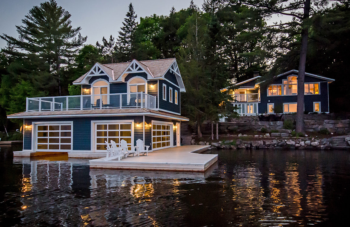 Traditional Boathouse with cedar shake roof in Muskoka