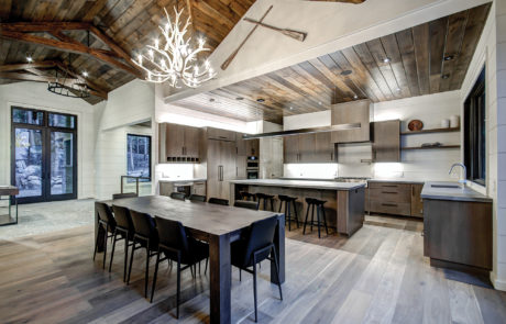 Contemporary open concept kitchen in Muskoka Cottage mixed with traditional timber trusses