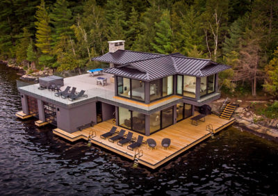 Luxury boathouse in Muskoka with standing seam steel roof