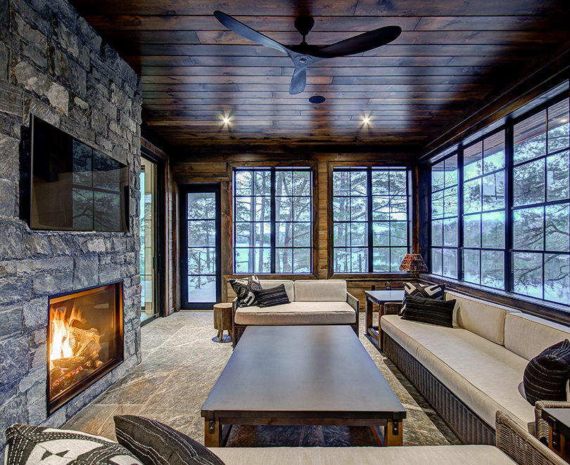 Stone floor Muskoka Room with stone fireplace