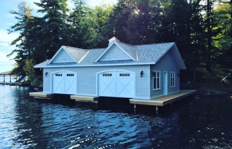 2 slip one level boathouse built by PattyMac in Muskoka