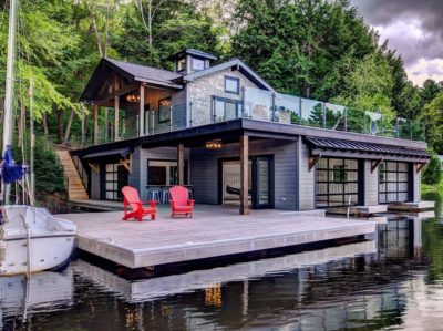 Roll-down bar window and bi-fold accordion doors make this contemporary Muskokan boathouse easily accessible