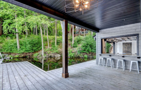 Walk-up bar and covered lounge area for Muskoka boathouse by PattyMac
