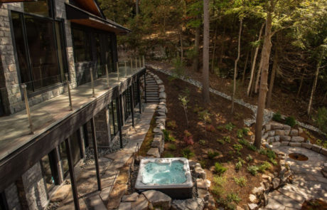View from second floor of landscaping in Muskoka and stone fire pit