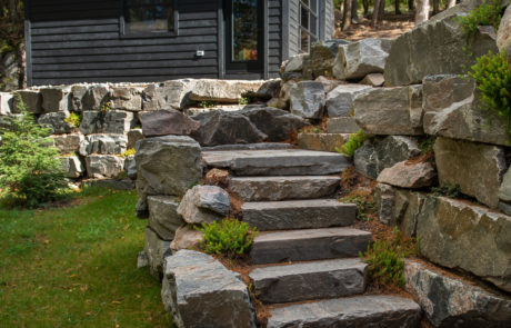 Stone steps down to the boathouse from a changing area in Muskoka