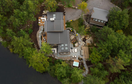 Contemporary landscaping at a modern Muskoka cottage by PattyMac