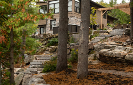 Stone retaining wall and landscaping by PattyMac