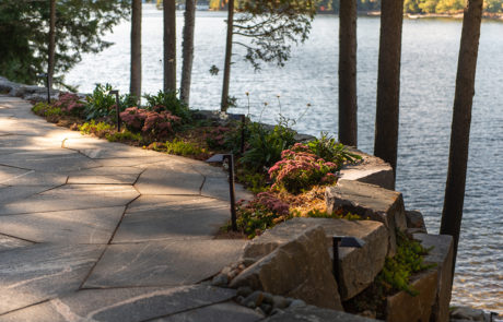 Stonework and patio with retaining wall and lightscaping by PattyMac