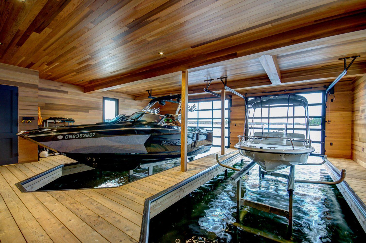Clear cedar finished boathouse built by PattyMac in Muskoka