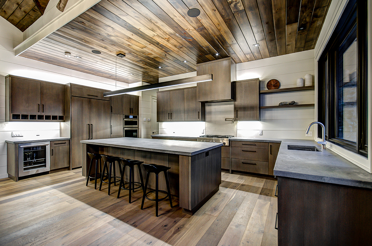 Wood kitchen with open shelving and open floorplan with large island for high end Muskoka cottage