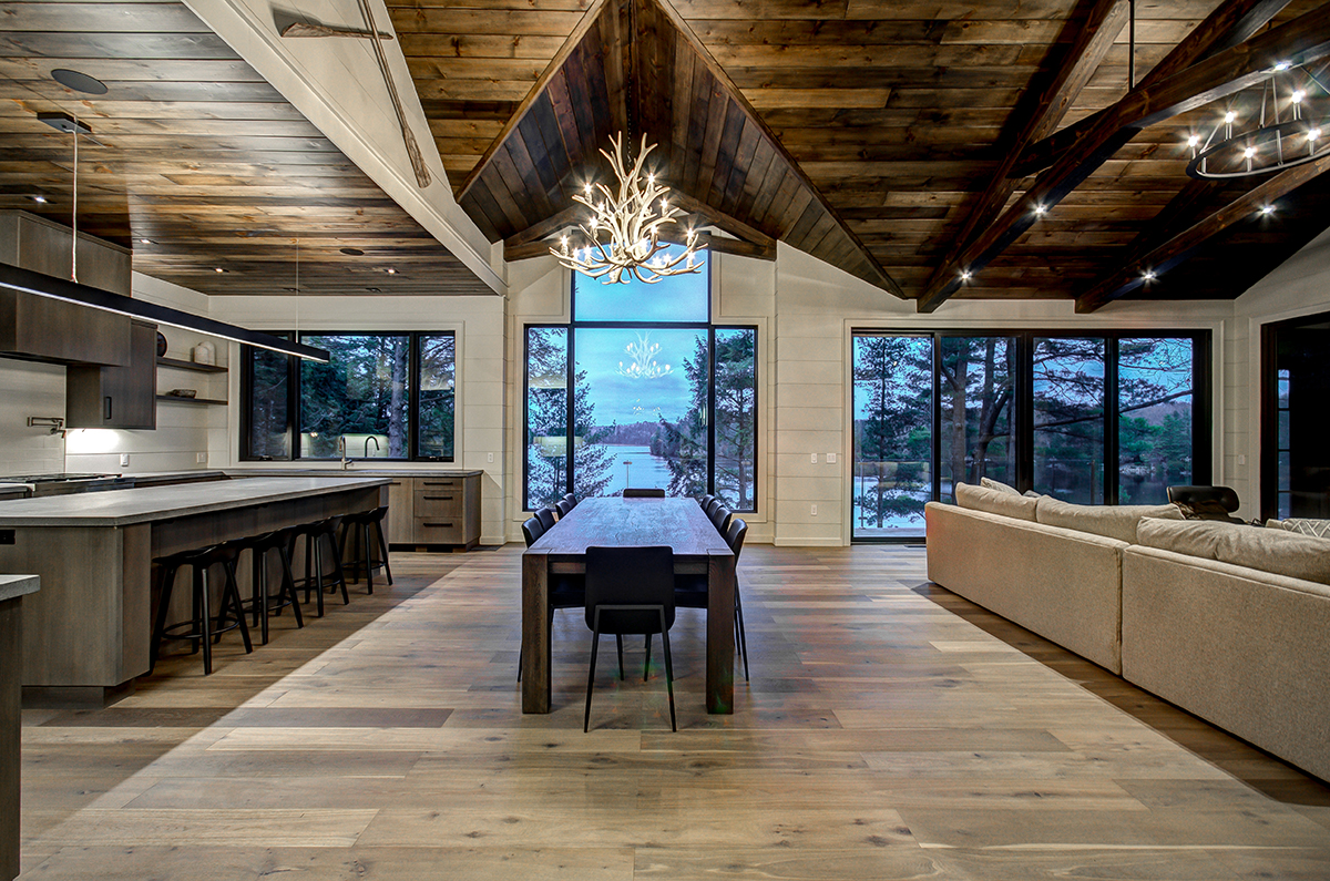 Timber trusses and wood planked ceiling in high end Muskoka cottage