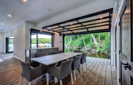 Dining lounge and walk-up bar in modern Muskoka boathouse built by PattyMac