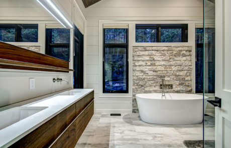 Contemporary 4 piece bathroom with double vanity and stone accent wall by PattyMac