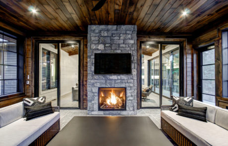 Modern and contemporary Muskoka room with double sided fireplace by Patty Mac
