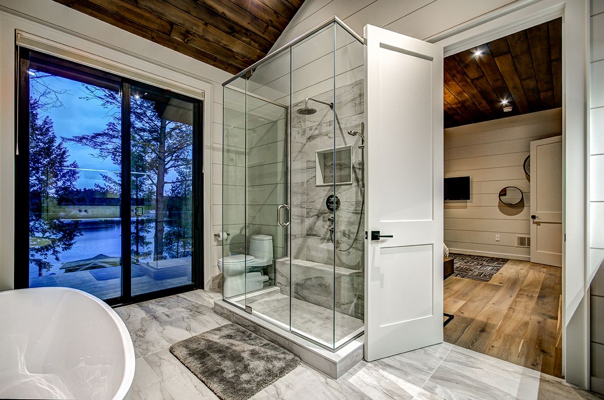 Steam shower in Master Bedroom ensuite with private balcony in high end Muskoka cottage