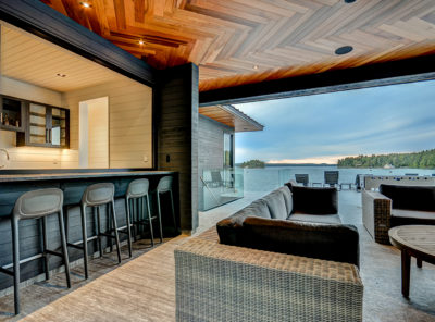 Contemporary bar lounge at a Muskoka boathouse by PattyMac