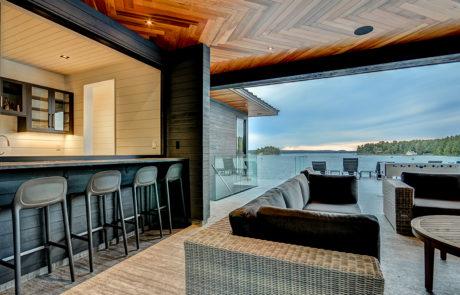 Contemporary bar lounge at a Muskoka boathouse by PattyMac