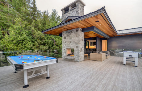 Lounge area of second floor Muskoka boathouse included a pool table, foosball, bar and hot tub