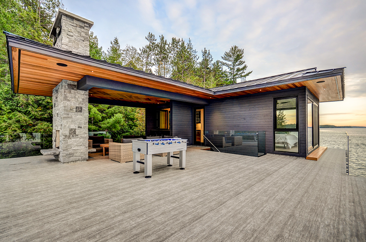 Second floor boathouse with glass railings and a luxury lounge by PattyMac