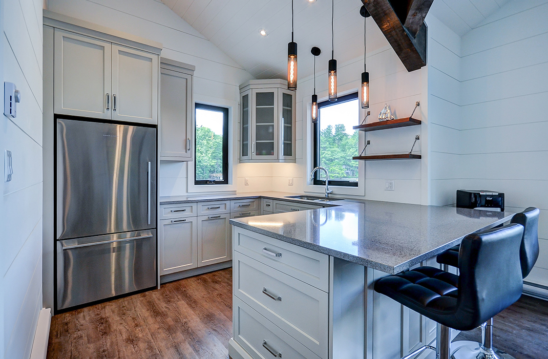 Contemporary shiplap boathouse interior with kitchenette and full fridge built by PattyMac