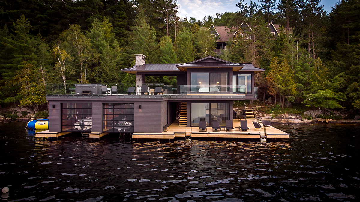 Contemporary boathouse with 2 slips and cantilevered bedroom of Muskoka cottage by PattyMac