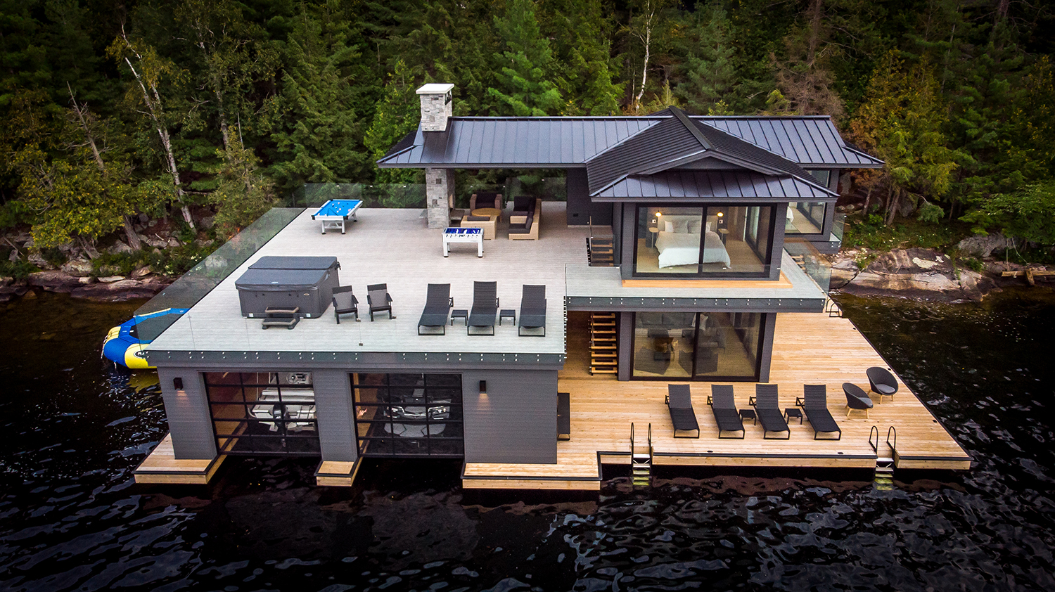 Contemporary boathouse with standing seam steel roof by PattyMac