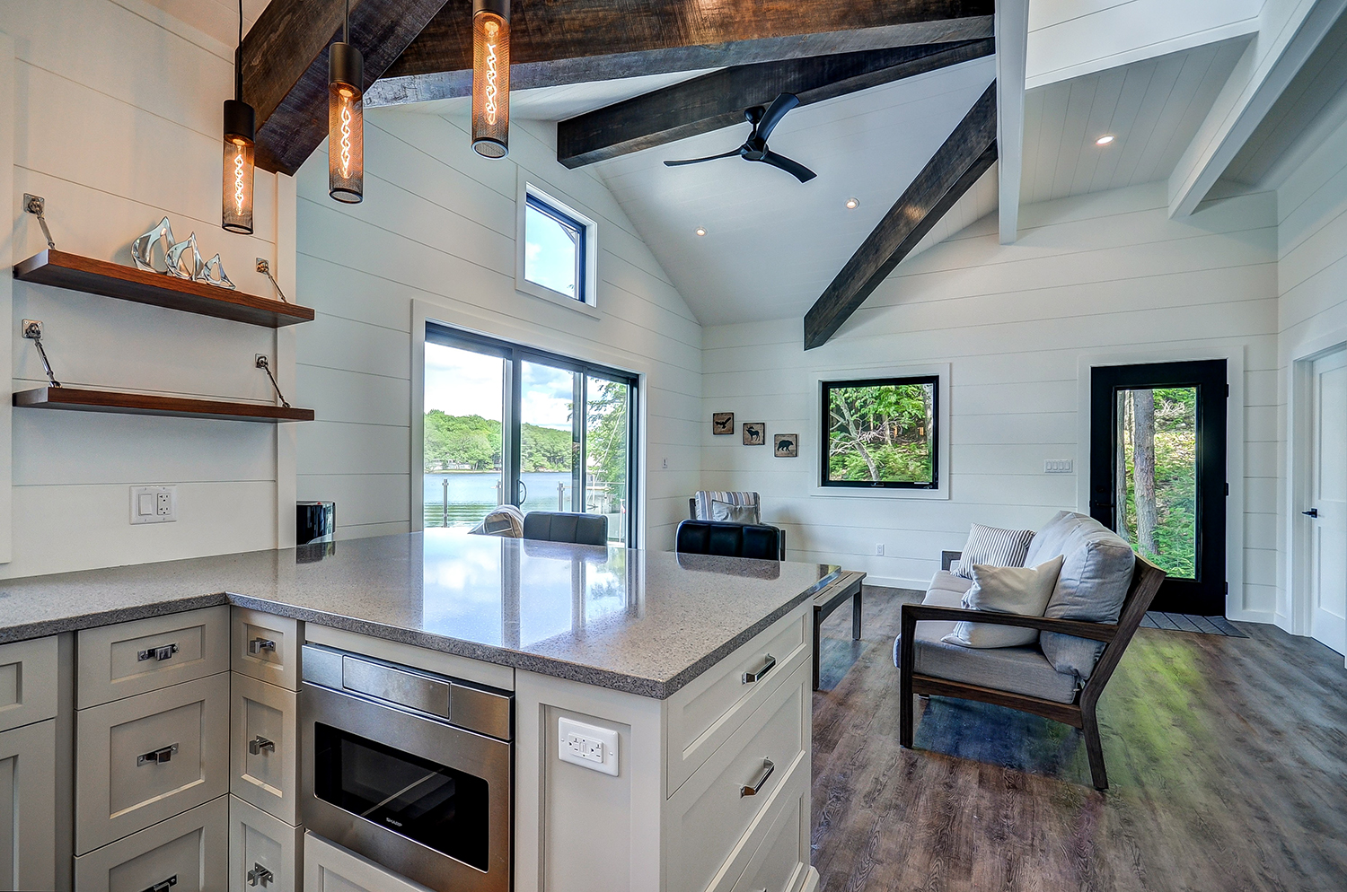 Modern boathouse with custom timber trusses and white shiplap