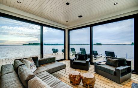 Contemporary lake level boathouse
