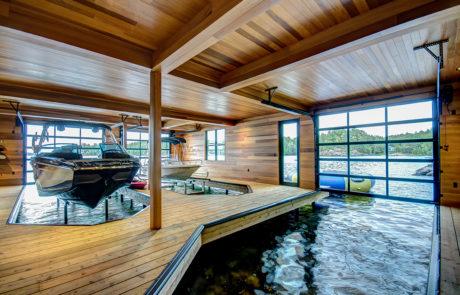 Muskoka boathouse finished with clear cedar with 3 slips by PattyMac