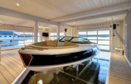Muskoka 1-slip boathouse with finished interior and lounge built by PattyMac
