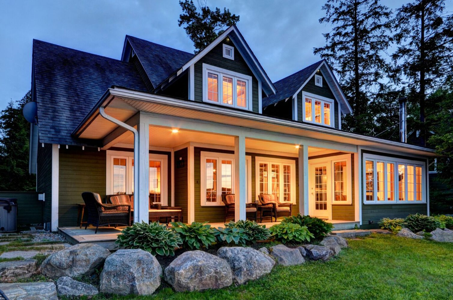 Traditional Muskoka cottage with lakeside porch by PattyMac