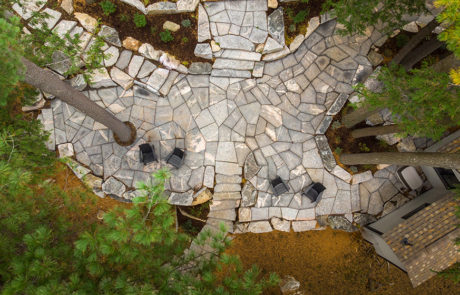 Aerial view of landscape work using flagstone for large patio lounge