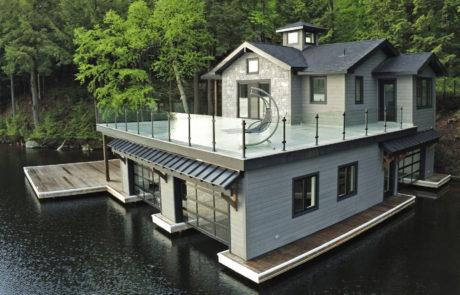 3 slip Muskoka boathouse with glass railings by PattyMac