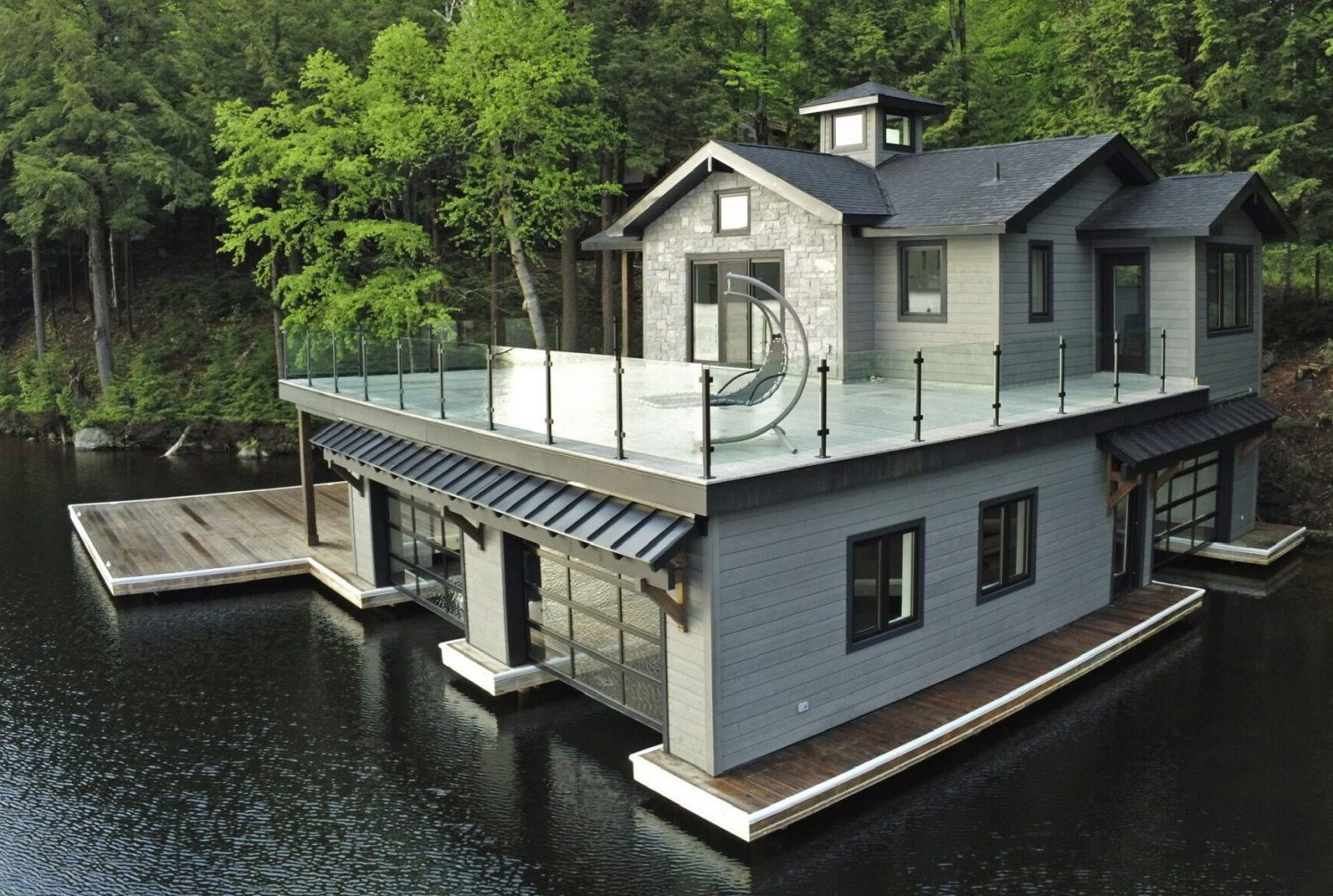 3 slip Muskoka boathouse with glass railings by PattyMac