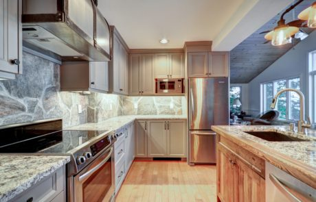 Traditional shaker style kitchen with built-in storage and stainless steel appliances