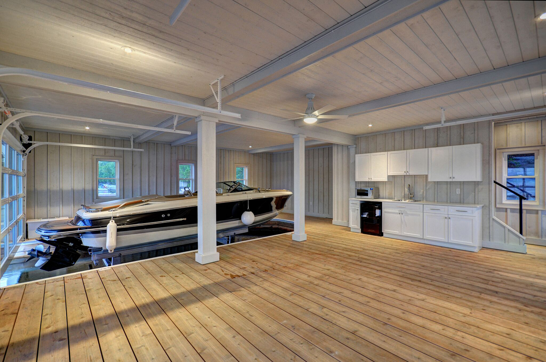 Kitchenette and lounge space of a Lake Muskoka boathouse by PattyMac