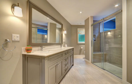 Custom bathroom with large walk in shower with glass barn door enclosure by PattyMac